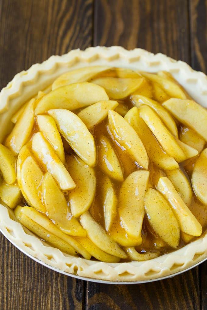 Apple filling inside of a pie crust.