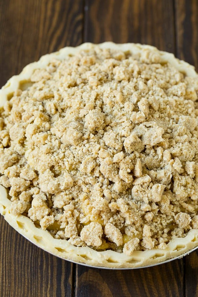 Brown sugar topping on top of an apple pie.