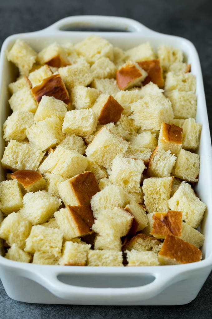 Cubes of bread in a baking dish.