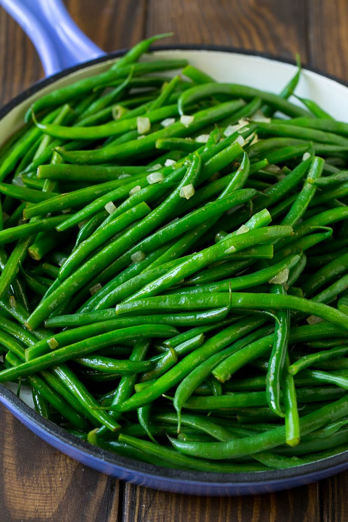 Cooked green beans tossed with diced onion.