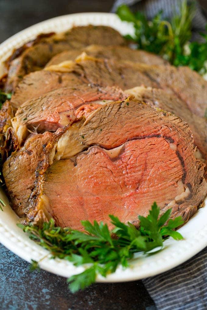 Sliced prime beef on a serving platter.