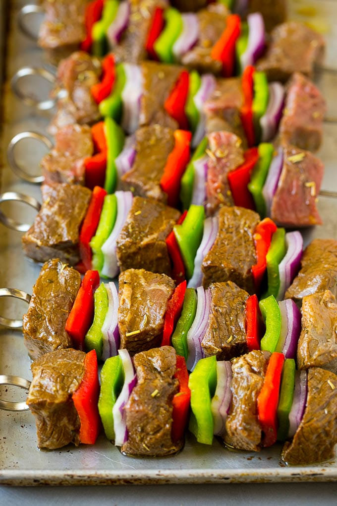 Raw beef skewered with peppers and onions.