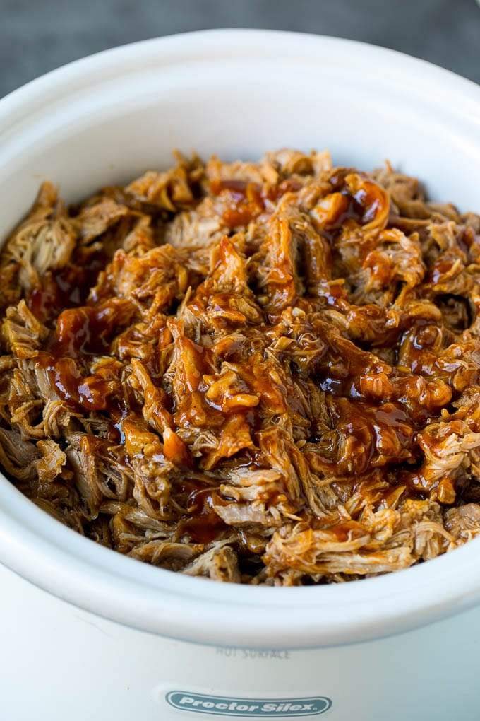Slow cooker pulled pork, shredded and tossed in BBQ sauce.