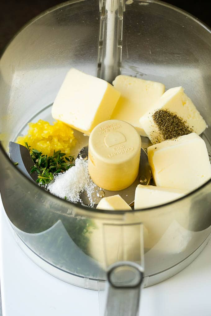 Butter, garlic herbs and seasonings in a food processor.