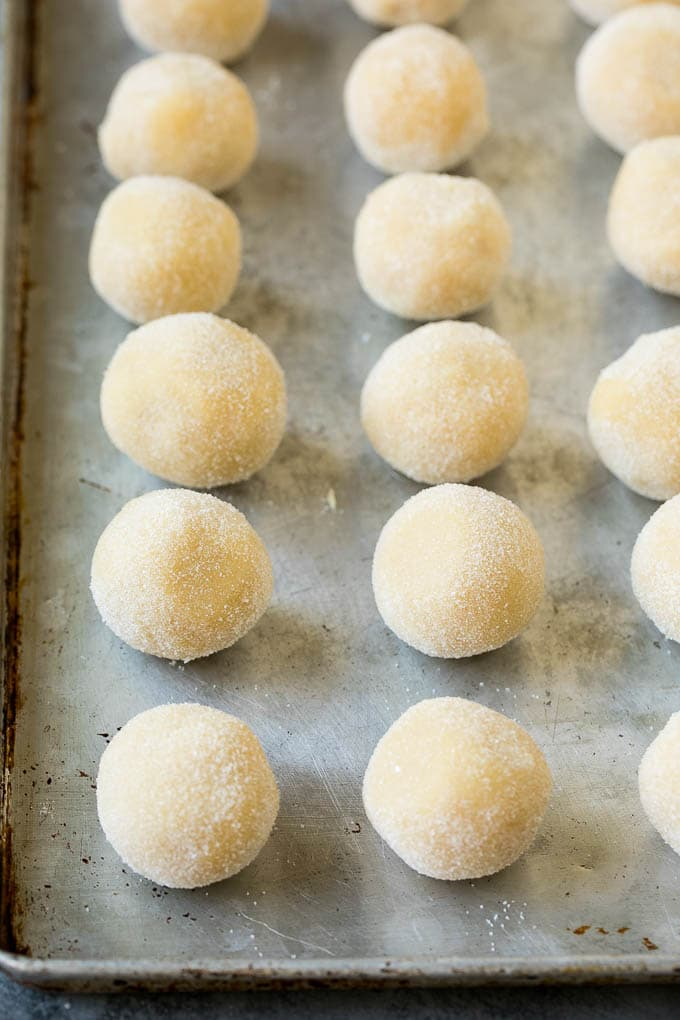 Balls of cookie dough rolled in sugar.
