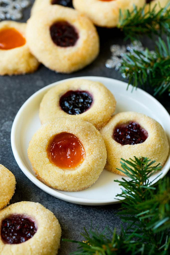 A plate of jam filled thumbprint cookies.