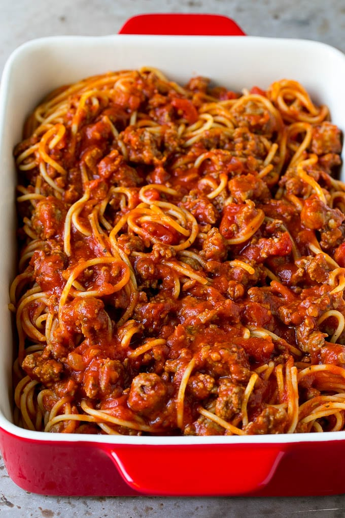 Spaghetti tossed with meat sauce in a baking dish.