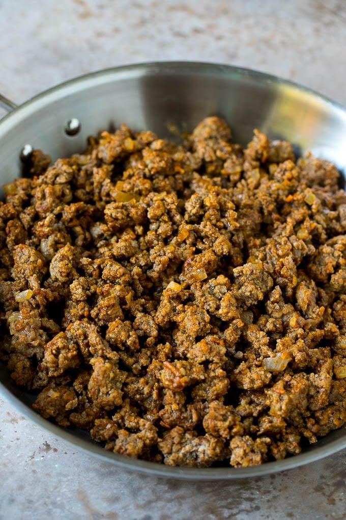 Seasoned ground beef in a skillet.