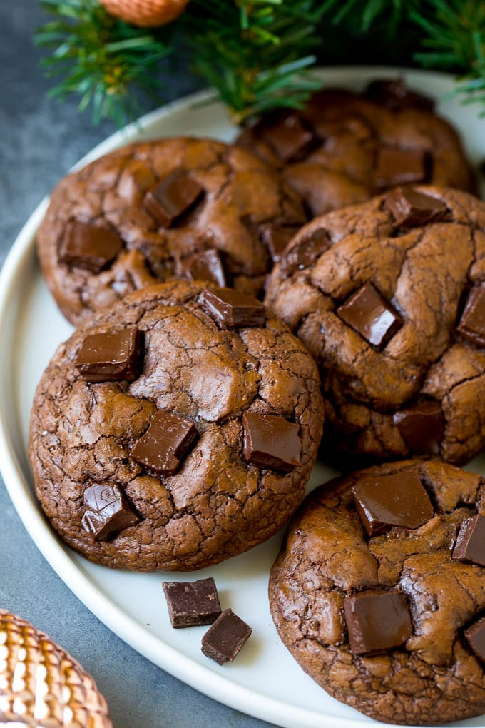 Brownie cookies on a serving plate, topped with chocolate chunks.