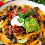 Carne asada fries topped with melted cheese, steak, salsa and guacamole.
