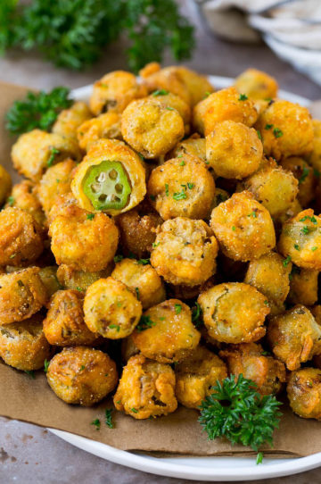 A serving plate of fried okra garnished with parsley.