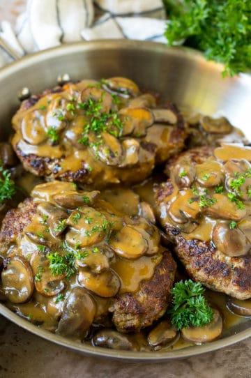 Hamburger steak topped with mushroom gravy and chopped parsley.