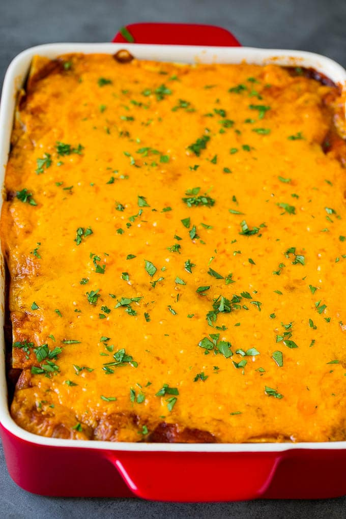 A baked Mexican casserole topped with melted cheese and cilantro.