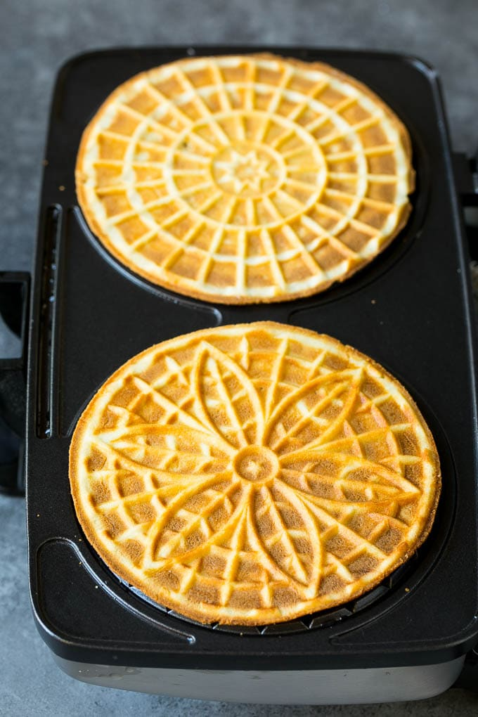 Baked cookies inside a pizzelle iron.