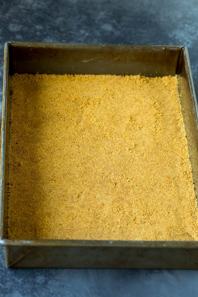 Graham cracker crust in a baking dish.