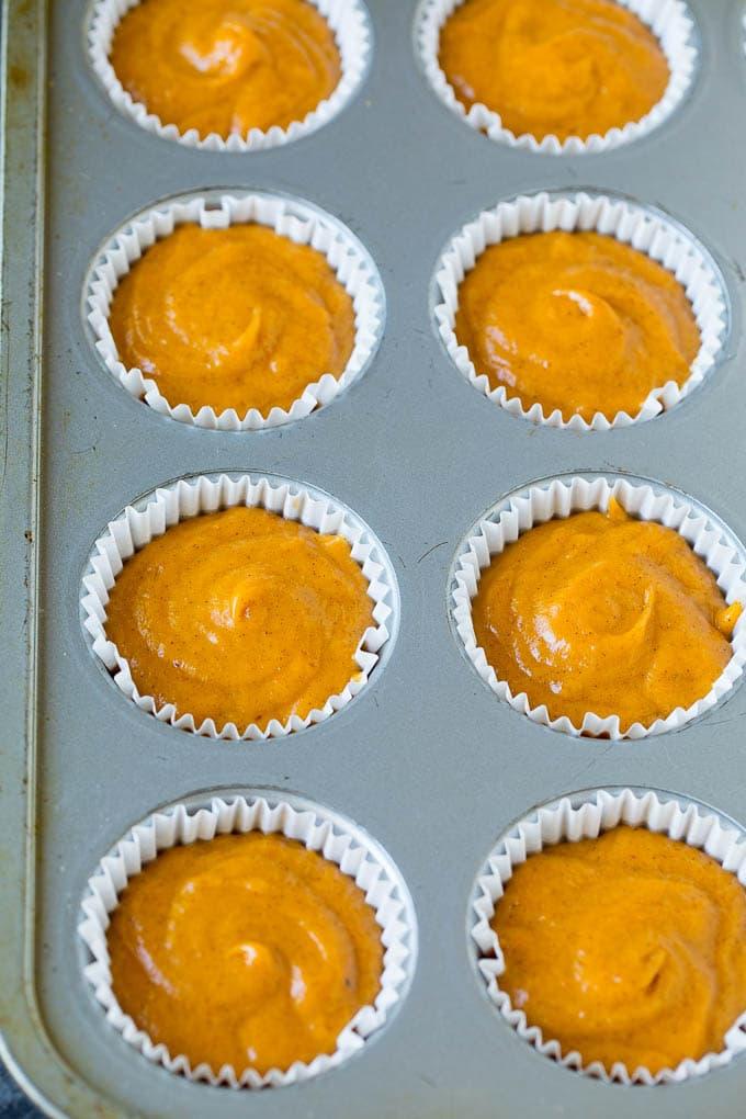 Pumpkin batter poured into a baking tin.