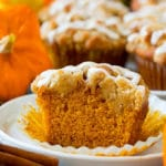 Pumpkin muffins topped with brown sugar streusel and vanilla glaze.
