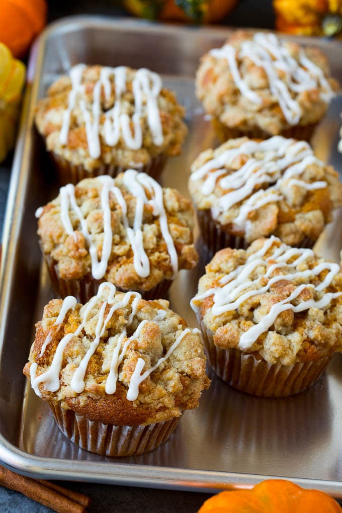 A tray of pumpkin muffins topped with glaze.