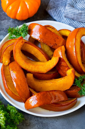A plate of roasted pumpkin garnished with parsley.