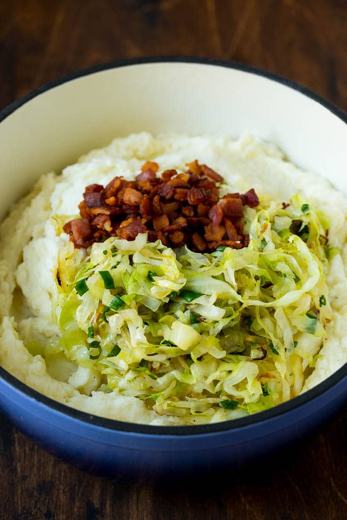 Mashed potatoes with bacon and cabbage on top.