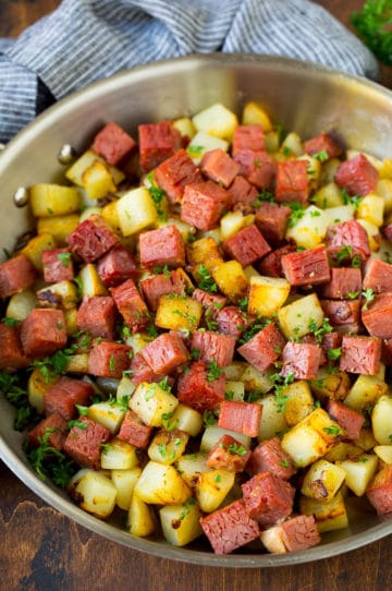 Corned beef hash with potatoes, onions and fresh herbs.
