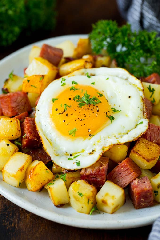 A plate of corned beef hash topped with a fried egg.