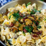 Farfalle pasta with spinach and mushrooms in a creamy sauce.