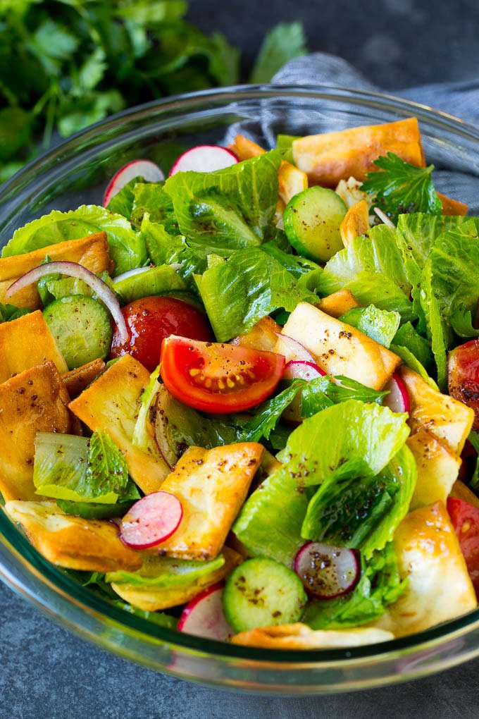 Fattoush salad with lettuce, cucumber, tomato and pita chips.