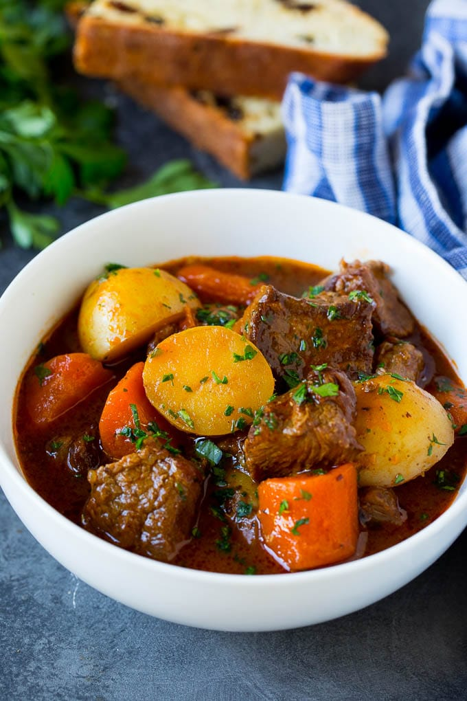 A bowl of Irish stew garnished with parsley.