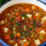 Manhattan clam chowder with tomatoes, potatoes, vegetables and bacon.
