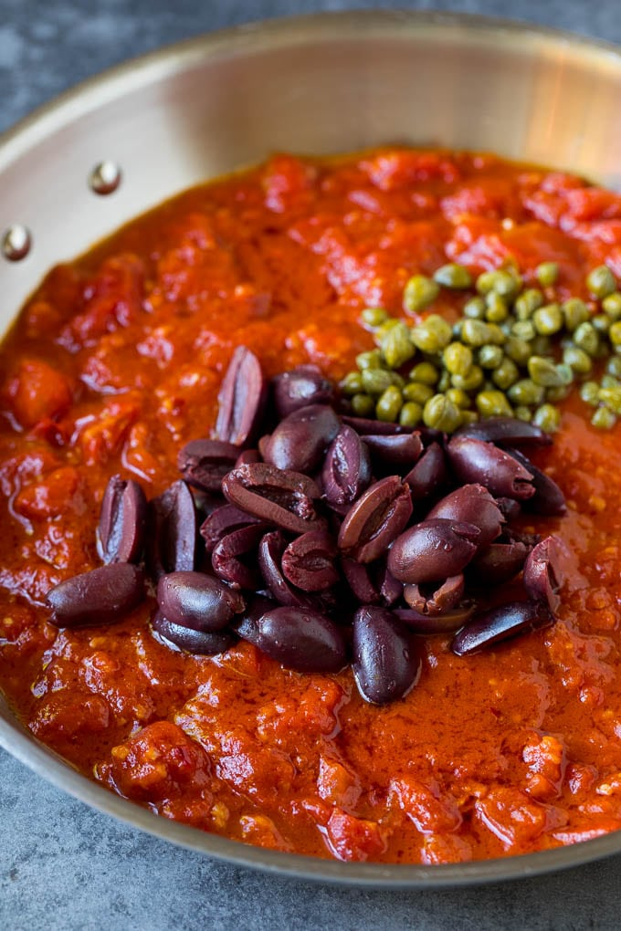 Tomato sauce with olives and capers on top.