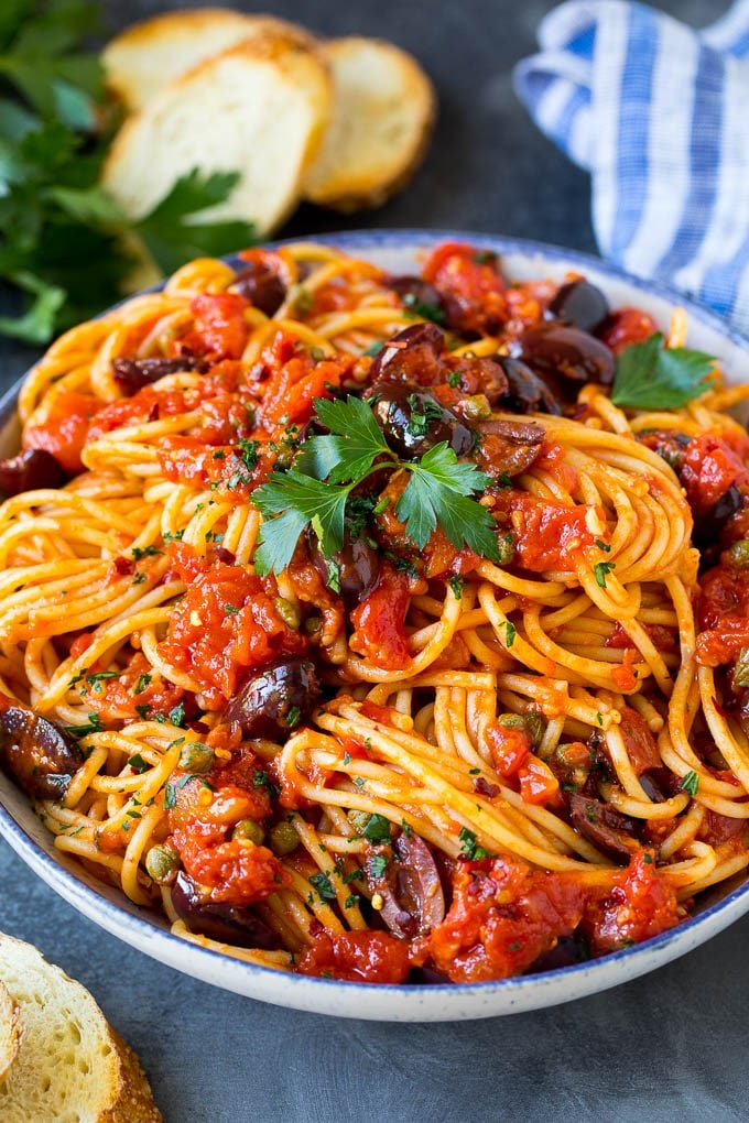 Pasta puttanesca with spaghetti tossed in a homemade tomato sauce.