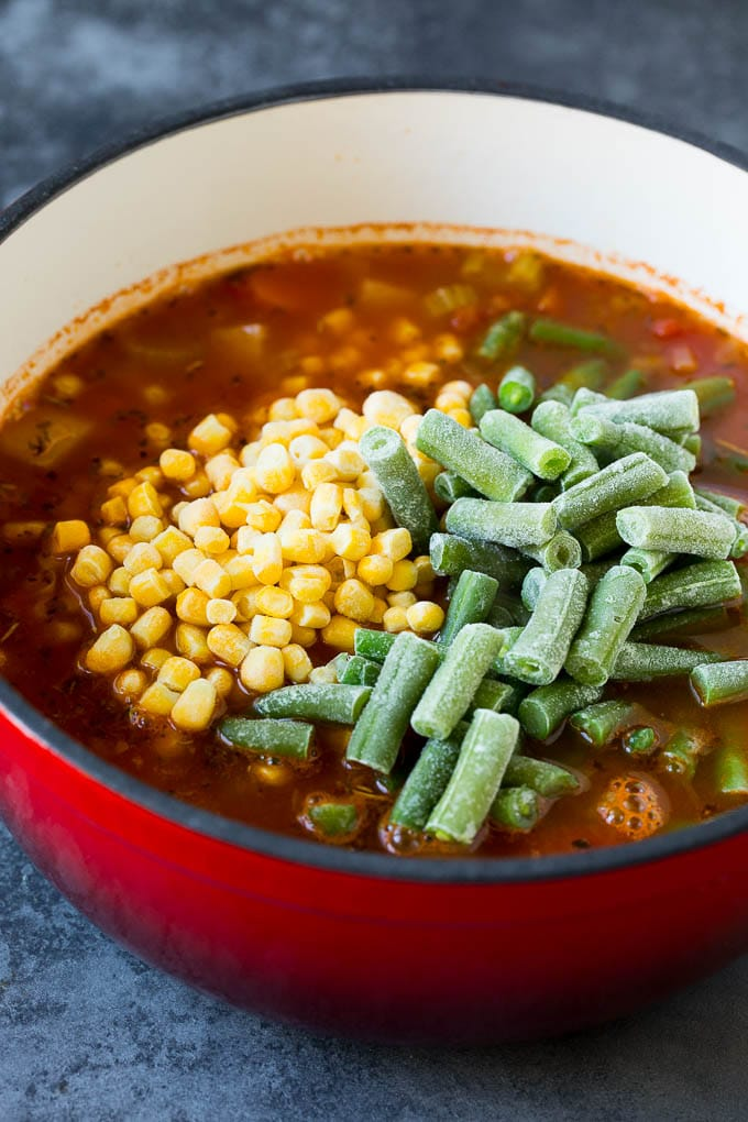 Soup with frozen corn and green beans on top.