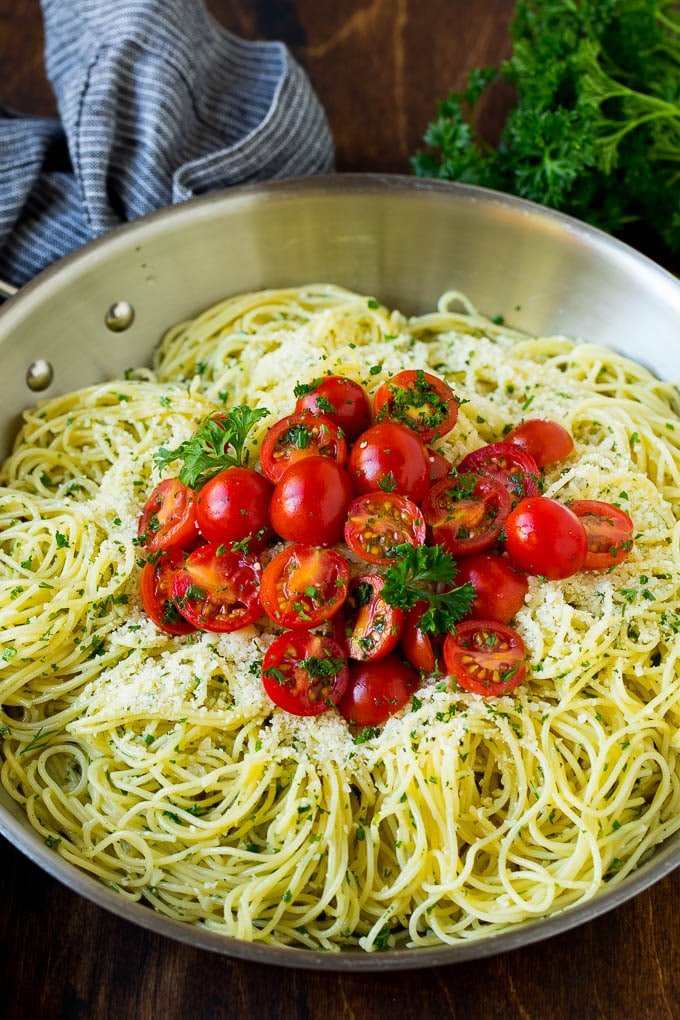Garlic and herb angel hair pasta topped with fresh tomatoes.