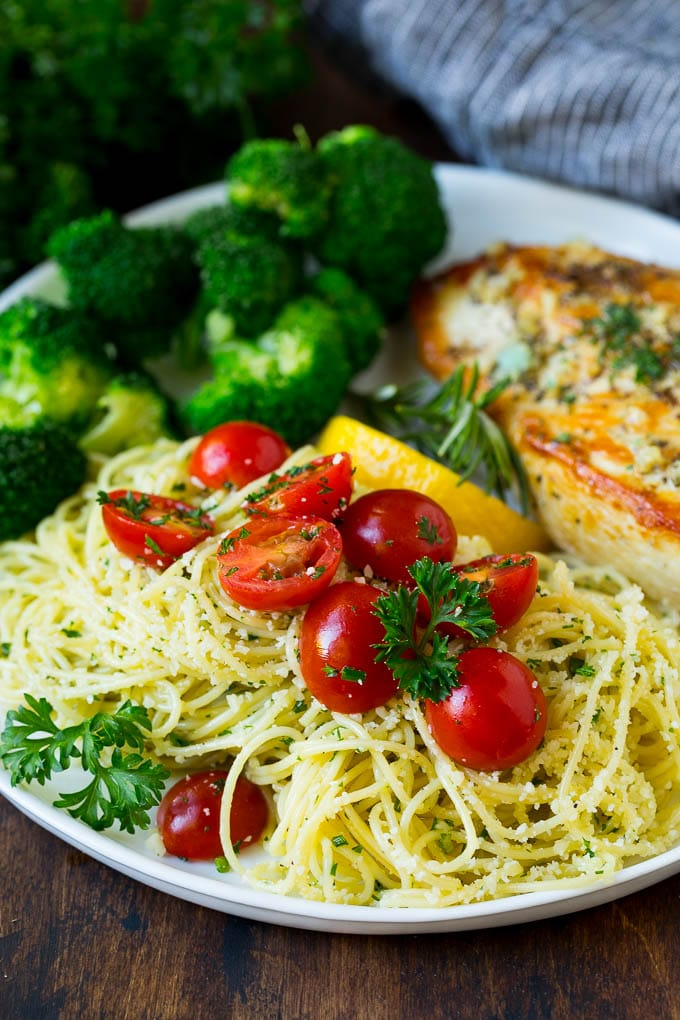 Angel hair pasta served with chicken and broccoli.