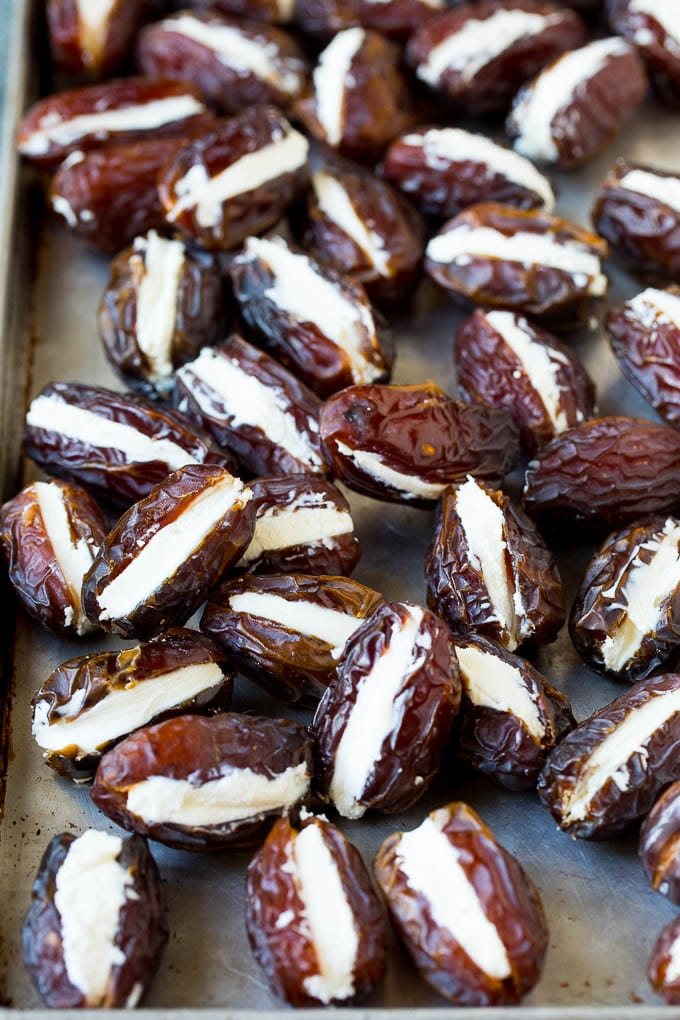 Dates cut in half and filled with goat cheese.