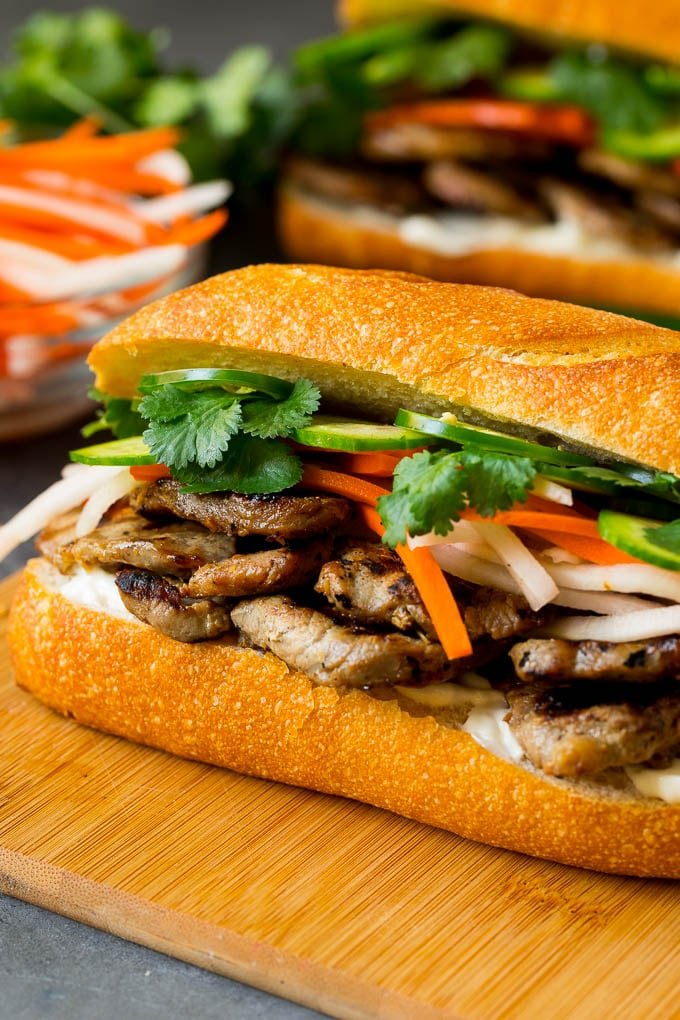 A banh mi sandwich layered with pork, pickled vegetables and herbs.