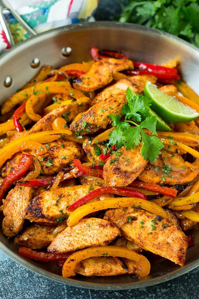Chicken fajita marinade served over sliced chicken and vegetables.