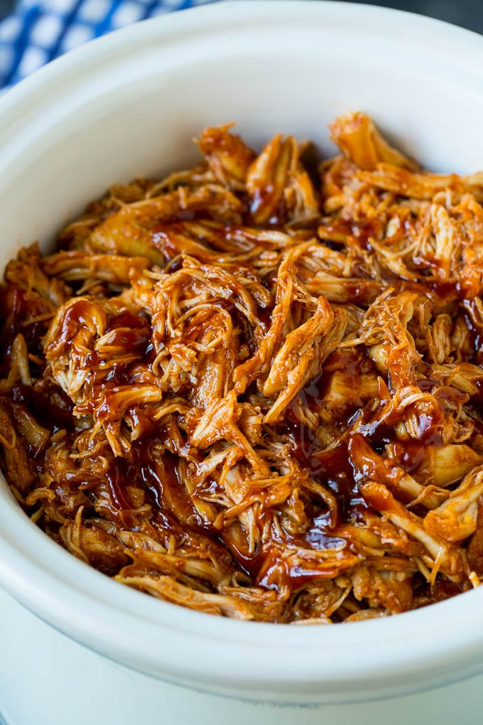 Shredded crockpot BBQ chicken in a slow cooker.