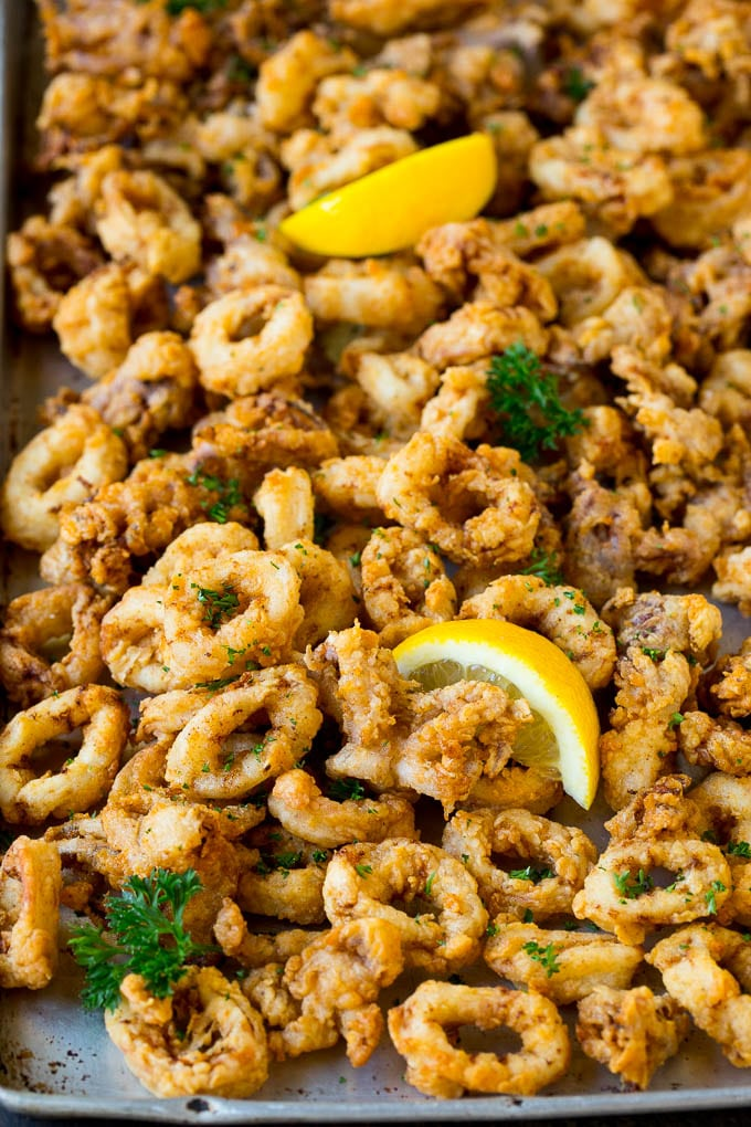 Fried calamari garnished with lemon and parsley.
