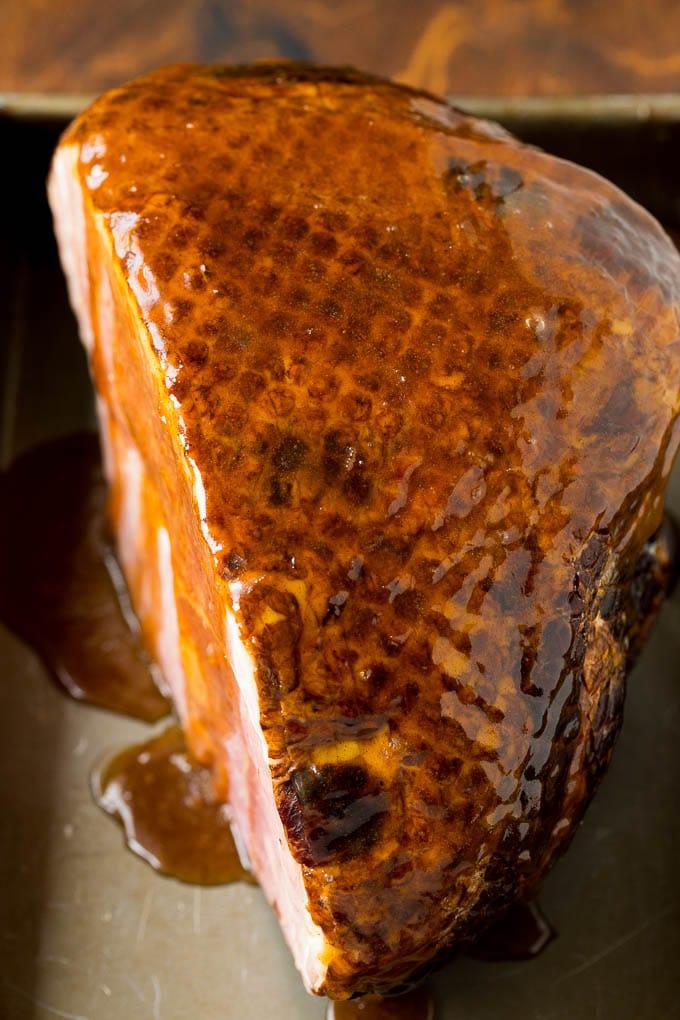 A ham covered in brown sugar glaze.