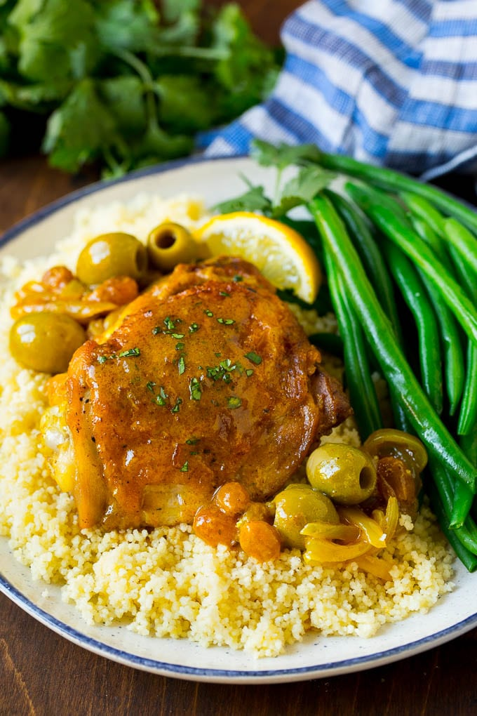 A plate of Moroccan chicken served over couscous.