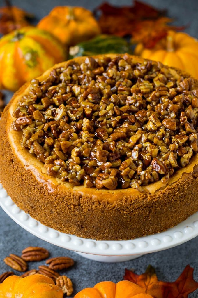 A pecan pie cheesecake topped with a gooey brown sugar glaze.