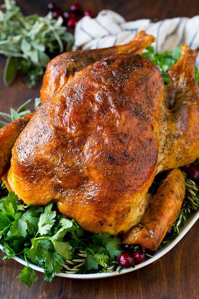 A cooked turkey seasoned with homemade turkey rub.