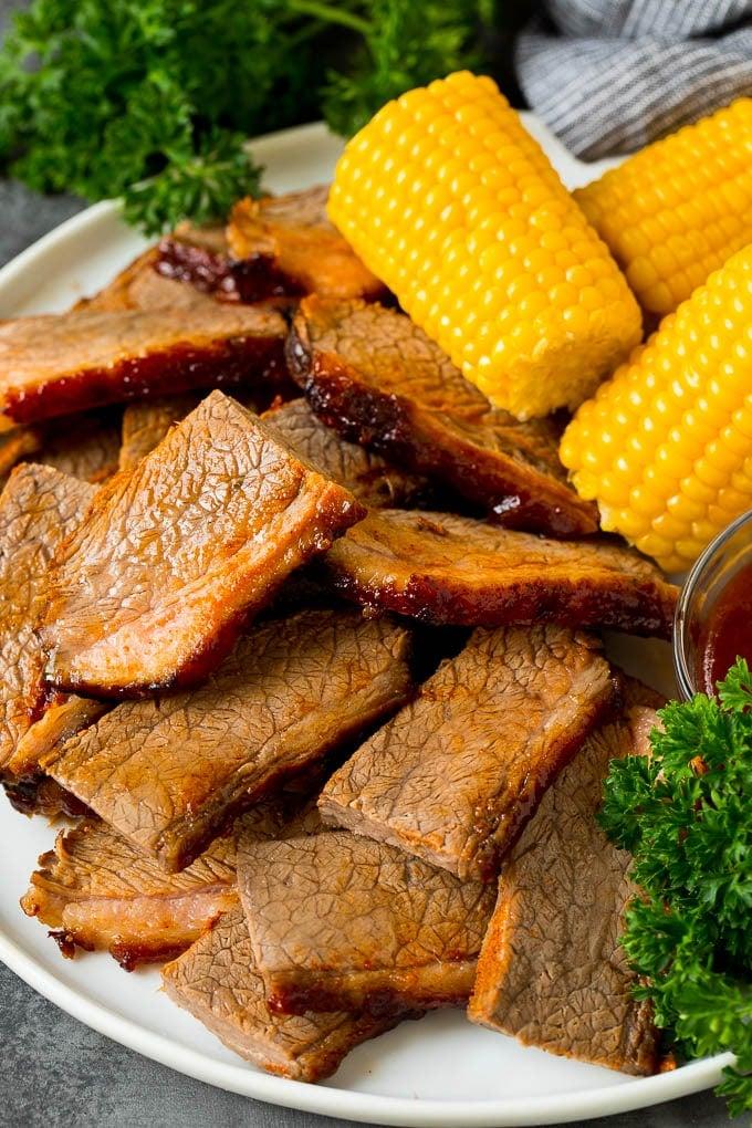 Sliced beef brisket on a serving platter.