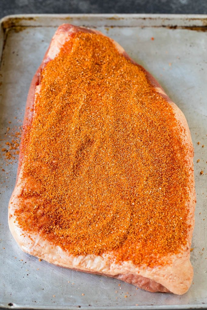 Brisket rub spread over a beef brisket.
