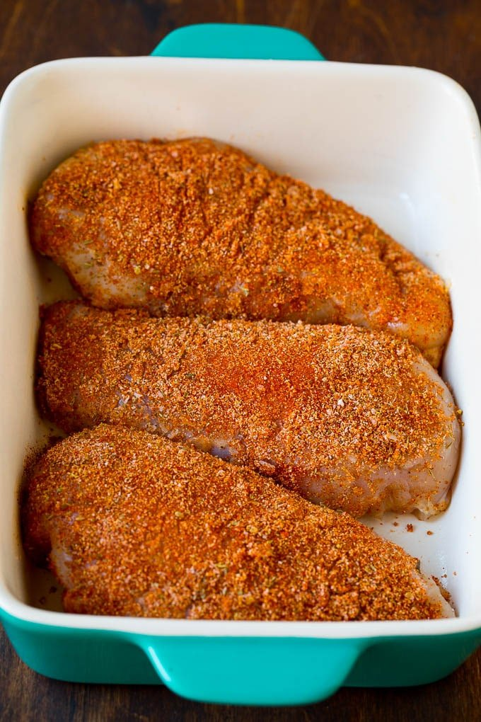Spice crusted chicken breasts in a baking dish.