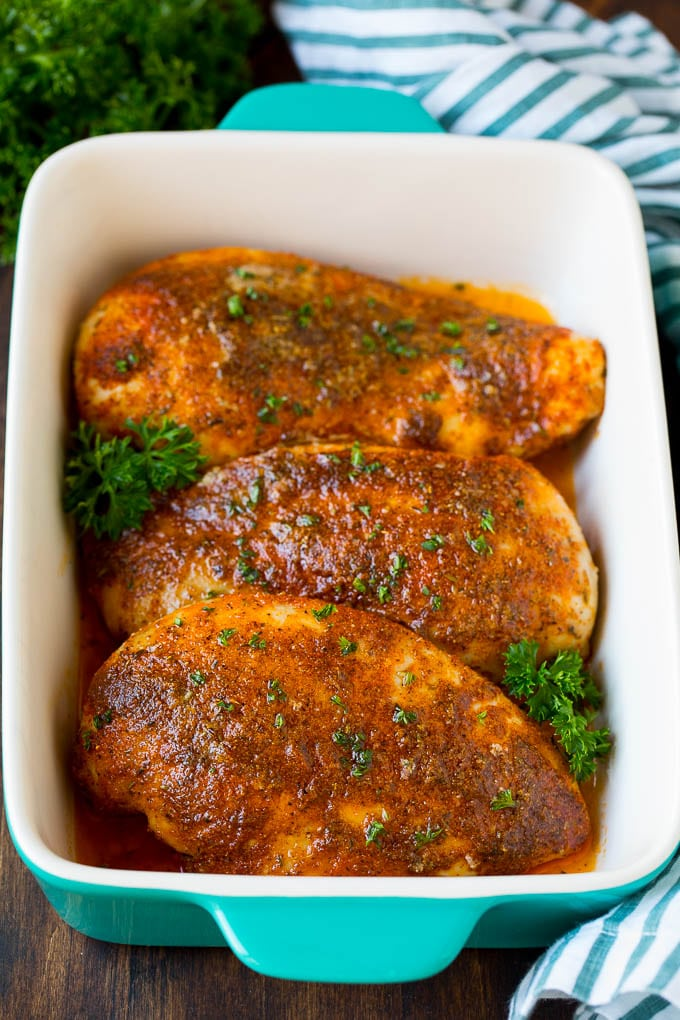Baked Cajun chicken garnished with fresh parsley.