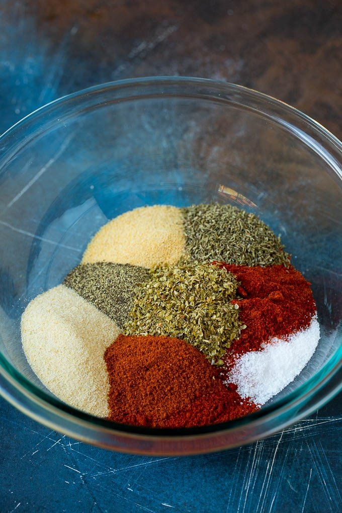 Paprika, garlic powder, onion powder and herbs in a mixing bowl.