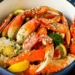 A pot of crab legs tossed in garlic butter.